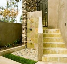California Dreamin'  A host of tasty elements come together in this eye-candy outdoor shower in southern California. Stone tile, natural rock, and stucco give architectural snap. On the practical side, a foot shower (operated by a diverter) washes tootsies, and runoff waters a carpet of grass at the shower's entryway.