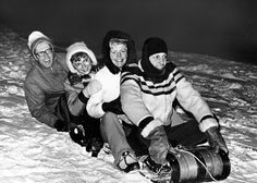 Fifty couples gathered at the Omaha Country Club on Jan. 12, 1974, for a tobogganing party hosted by Dr. and Mrs. Stanley Davis and Mr. and Mrs. Wayne Meier. Sliding down the slopes of the golf course are, from left, Frank Gaines, Mrs. James Warren, Mrs. Walter Horning and James Warren. THE WORLD-HERALD