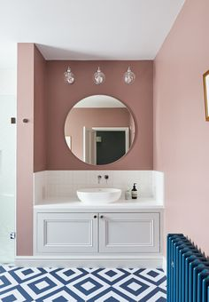 This grand family bathroom features pink walls, a patterned navy and white bathroom floor and traditional cast iron blue radiators. The huge shower sits opposite a roll-top bath, complete with navy blue feet to compliment the striking theme. Pink Bathroom Paint, White Bathroom Decor, Bathroom Colors, Bathroom Interior Design, Paz Interior, Bathroom Floor Tiles, Bathroom Renos, Bathroom Wall, Small Bathroom