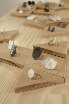 Simple but adds more perceived value just by placing rings on the wood blocks instead of directly on the table.