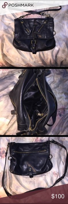 Extremely soft Black leather crossbody bag I have loved this bag, it's in stellar condition, the leather is incredible soft and very durable sabina Bags Crossbody Bags
