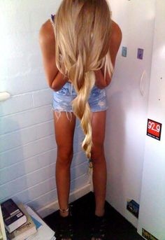 For long hair: flip hair upside down, spray with hairspray, twist and pin, flip upright.