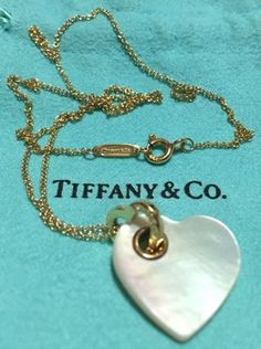"TIFFANY & CO - Solid 18k 18kt Gold Mother of Pearl HEART Pendant and 16"" Chain. Get the lowest price on TIFFANY & CO - Solid 18k 18kt Gold Mother of Pearl HEART Pendant and 16"" Chain and other fabulous designer clothing and accessories! Shop Tradesy now"