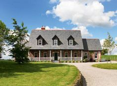 For a traditional style that is cost-effective, take inspiration from New England homes.
