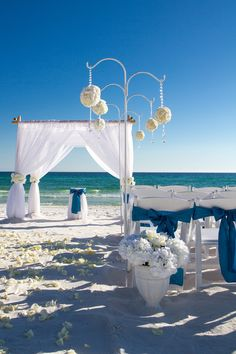 I love the hanging floral arrangements at this Panama City beach wedding!