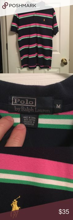 Mens Polo Ralph Lauren size medium polo short sle Never worn-great condition-non smoker home. The colors include navy blue, pink, green, white, with a yellow logo. Polo by Ralph Lauren Shirts Polos