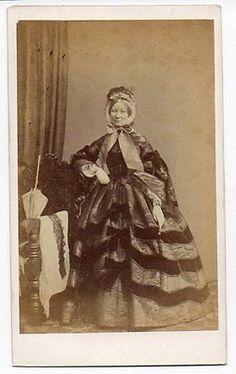1860s Silk two-piece dress with huge sleeves, lavish velvet trim & heavily decorated bonnet, CDV.