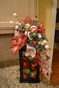 fill lantern with candy themed Christmas floral items Elf Christmas Decorations, Christmas Lanterns, Grinch Christmas, Christmas Centerpieces, Winter Christmas, Christmas Home, Christmas Wreaths, Christmas Ornaments, Yard Decorations
