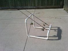 homemade rod holder for shore fishing | ... design made out of 1 1/2 pvc. Really makes shore fishing much easier