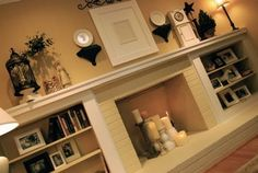 Decorating a long mantle. Might adopt the idea of mounting fixtures to the wall, will give dimension.
