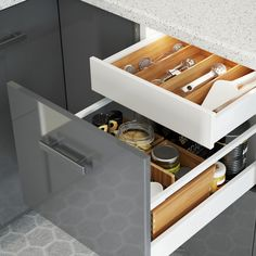 The drawer-within-a-drawer feature in the IKEA SEKTION kitchen helps to make sure there's plenty of storage space to keep you organized, and keeps the outside of your cabinets simple & clean!