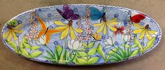 Large skinny platter painted by Mary at Damariscotta Pottery ! Very spring!!