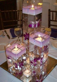 Purple Flowers, Ribbons, Candles, & Mirror Wedding Centerpiece