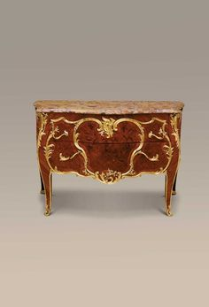 Maison Millet, A French ormolu-mounted kingwood, bois satine, marquetry and parquetry bombe commode, Paris, late 19th century
