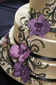 Beautiful silver cake topped with purple orchids