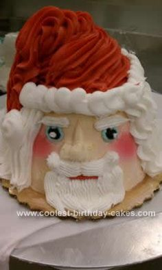 Homemade Santa Claus Cake: I made this Santa Claus cake using two four inch round petite cakes and a cupcake. I iced the two petite cake and iced the cupcake up side down onto the