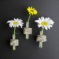 ***Listing is for a set of 3 small magnetic log vases***  Flowers NOT included  These small vases are perfect for displaying the wee fistful of