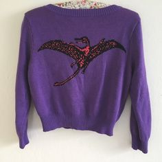 "Vintage Pterodactyl Dinosaur BJ Purple Cardigan Super adorable kawaii vintage Betsey Johnson purple King cropped sweater featuring a pink dinosaur on the back. Size medium in great condition no flaws needs washing vintage store smell, easy fix! Fabric: cotton/wool Measurements: Length 16.5"" Chest 16"" Sleeve 17.5"" YES to: Bundle Discounts NO to: Trades / Modeling / Holds  Happy Poshing!!  Betsey Johnson Sweaters Cardigans"