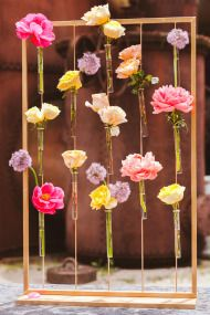 Love these suspended bud vases in a frame