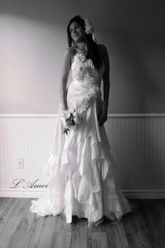 This gorgeous floor length vintage inspired fairy silk satin tulle gown wedding dress. It has an A-line neck with handmade flowers and fitted bodice, We