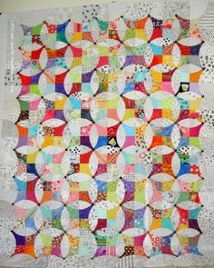 Jaye Lapachet's Flowering Snowball Quilt. I love the scrappy mix of lights and brights. I especially like the places where the contrasts vary a little and blink out. Lovely!