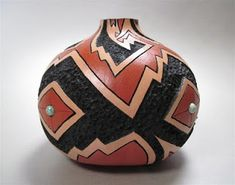 "Finally completed ""Earth Song"", a carved and painted gourd done in the style of Pueblo pottery. This piece turned out better ..."