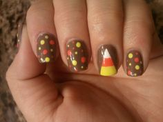 Candy Corn Nails !  I think I'd use black or purple instead of brown