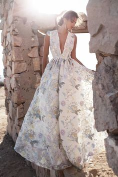 Lurelly Diana Gown is dreamy.. We love the pastel color embroidered flowers throughout!