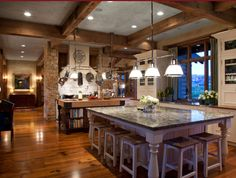 Massive kitchen with double islands, and mixed use materials....who (besides me) would love to have that massive island in the end of the photo?