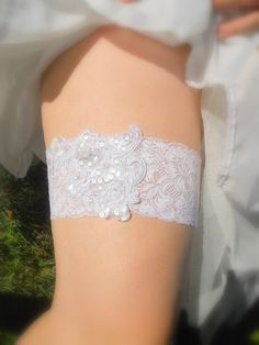 Plus size bridal garter in White stretch lace with sequin and embroidered applique.