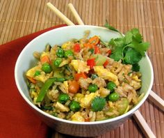 """Chicken Fried Rice - OAMC from Food.com:   I figured out the you can make this up in gargantuan quantities and freeze in containers for later. It really saves time..only about 10 minutes to heat up and is a great addition to any Chinese meal. Great way to use extra cooked rice too! I have a rice cooker and it's really easy to make extra. Cook time includes cooking """"real"""" rice and chicken."""