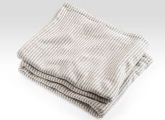 Slate Cotton Ticking Stripe Blanket, also available in Madder Red and French Blue.