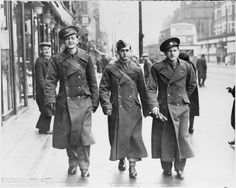 Three Czech soldiers walk down a street, somewhere in London in 1940.