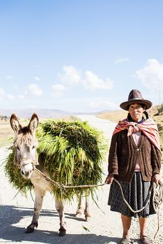 'Donkey and Peruvian Lady' Photographic Print by Kara Rosenlund. On the outskirts of the ancient town of Chinchero in Peru I came across this woman and her donkey. They had been working the fields on the nearby farmland and the bright light and pale blue skies of Peru just made this image pop. I love to be reminded of the simple way of life. © Kara Rosenlund  Shop here: http://shop.kararosenlund.com/donkey-and-peruvian-lady-photographic-print/
