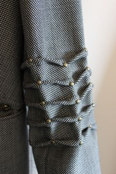 Studded Wave Tucks - fabric manipulation; creative sewing; pleated sleeve detail; innovative fashion design detail