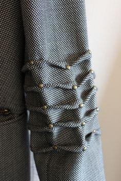 Studded Wave Tucks - fabric manipulation; creative sewing; pleated sleeve detail; innovative fashion design detail
