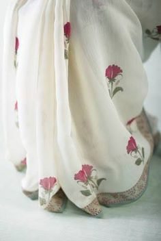 Refined handblock prints of gulaab and mogra blossoms accompany immaculate cypress trees dotted with metallic silver and gold mukaish embroidery – incredibly soft and lightweight, a delight for summer. #InBloom #GoodEarthSustain
