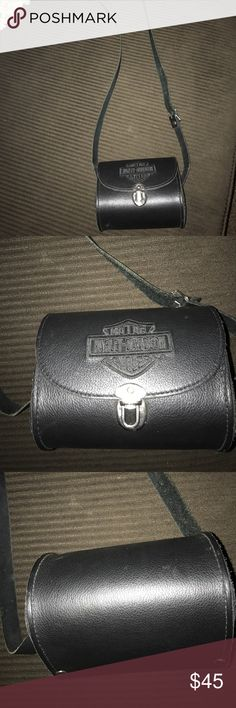 H-D SMALL BARREL PURSE USED 1x H-D SMALL BARREL PURSE IN EXCELLENT CONDITION USED 1x has Long strap can be used a cross body or just a shoulder purse it's all black with a Buckle for safety of your things ... !!! Harley-Davidson Bags Mini Bags