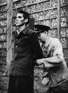 French Militiaman is Fastened to Stake Before his Execution, France, 1944 - HU031043 - Rights Managed - Stock Photo - Corbis. One of the six French militiamen found guilty of treason by collaborating with the Germans is fastened to a stake by a guard before his execution. September 13, 1944