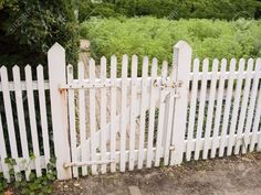 An Old White Picket Fence And Garden ...