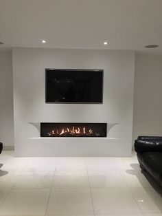 Tulp balanced flue gas fire with the superb undercover shaped fascia set in a false chimney breast with fully inset TV. Living Room Decor Fireplace, Fireplace Tv Wall, Linear Fireplace, Modern Fireplace, Living Room Tv, Fireplace Design, Fireplace Ideas, Fireplace Inserts, Wall Tv
