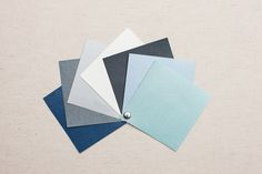 BUCKRAM. Buckram is a beautiful and very durable book cloth with a pearlized finish. From left: Sapphire, Steel, Pewter, Pearl, Lava, Aquamarine, Mint.