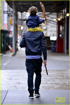 Orlando Bloom & son Flynn play with toy swords on the street in NYC