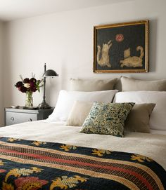 Here's the secret to a perfectly prepared bed: Start with great cotton sheets, add a cotton coverlet, then finish with a down duvet on top. That combination offers enough flexibility to deal with the most extreme temperature swings. Think a down comforter is pricey? Check Ikea for affordable ones.   - CountryLiving.com