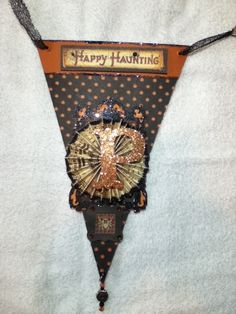 """Halloween Banner """"SPOOKY"""" 2nd and 5th pennant...Graphic 45 """"Happy Hauntings"""" paper, Cricut letters and frame, Recollections """"Witch's Dust"""" stickers."""
