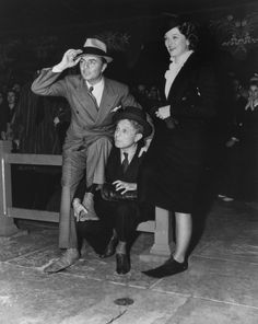 William Powell's Hand and Footprint Ceremony at Grauman's Chinese Theater, wth Myrna Loy looking on, 1936
