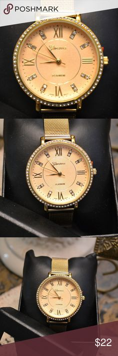 "Geneva Ladies Watch  Mesh Strap New never worn classy gold tone mesh strap watch in original box. Has a buckle closure and adjusts from 6 & 1/2 Inches up to 8 & 1/4 Inches. Approx. 9 & 1/4""l X 1 & 1/2""w. Perfect size for layering w/ bracelets etc. Very nice gold color not too light and not too orangy. It has tiny white crystals around the face and some accents on the face.  Japanese Quartz Movement-Stainless Steel Case Backing. Very nice looking watch. Geneva Platinum Accessories Watches"