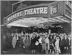 """First-nighters posing for the camera outside the Warners' Theater before the premiere of """"Don Juan"""" with John Barrymore, Washington DC, 08/06/1926. by The U.S. National Archives, via Flickr"""