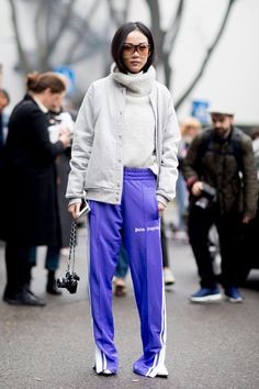 This activewear look is incredible, purple track pants with a snow white top and jacket, imagine looking just as good as you feel. Milan Fashion Week.