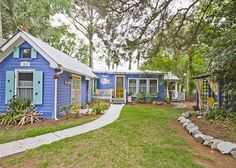 This blue and yellow bungalow is a vacation rental near Savannah, Georgia.